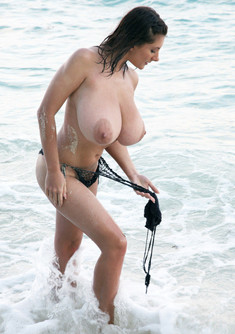 Huge titted girls in the sea, topless..