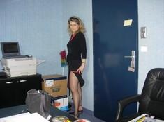 Mature secretary teasing boss with her..